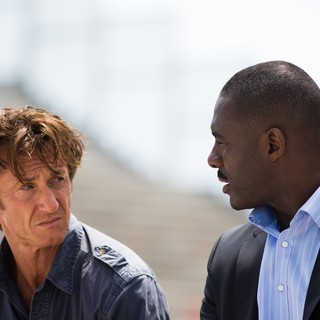Sean Penn stars as Martin Terrier and Idris Elba stars as DuPont in Open Road Films' The Gunman (2015)
