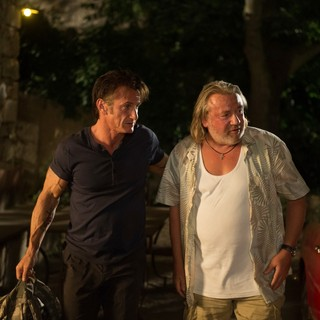 Sean Penn stars as Martin Terrier and Ray Winstone stars as Stanley in Open Road Films' The Gunman (2015)