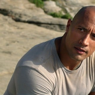 The Rock stars as Hank Parsons in Warner Bros. Pictures' Journey 2: The Mysterious Island (2012)