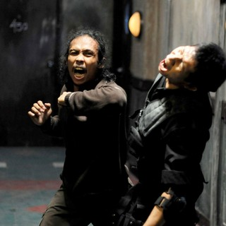 Yayan Ruhian stars as Mad Dog and Eka Rahmadia stars as Dagu in Sony Pictures Classics' The Raid: Redemption (2012). Photo credit by Akhirwan Nurhaidir.