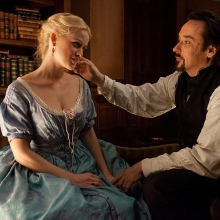Raven, The - Alice Eve stars as Emily and John Cusack stars as Edgar Allan Poe in Relativity Media's The Raven (2012)