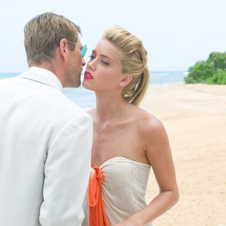 Aaron Eckhart stars as Sanderson and Amber Heard stars as Chenault in FilmDistrict's The Rum Diary (2011). Photo credit by Peter Mountain. - the-rum-diary-movie07