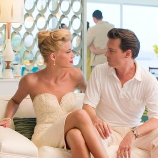 Amber Heard stars as Chenault and Johnny Depp stars as Paul Kemp in FilmDistrict's The Rum Diary (2011) - the-rum-diary04