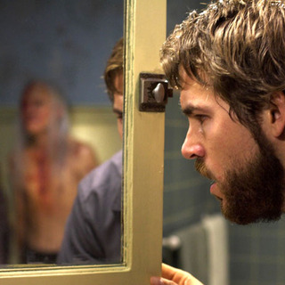 Ryan Reynolds as George Lutz in MGM's The Amityville Horror (2005)