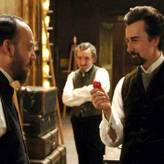 Paul Giamatti as Chief Inspector Uhl and Edward Norton as a magician named Eisenheim in The Illusionist (2006)