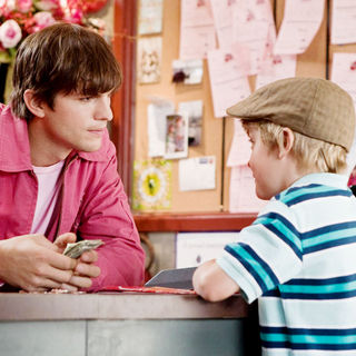 Ashton Kutcher stars as Reed Bennett and Bryce Robinson stars as Edison in New Line Cinema's Valentine's Day (2010)