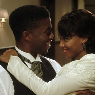 Chadwick Boseman stars as Jackie Robinson and Nicole Beharie stars as Rachel Isum in Warner Bros. Pictures' 42 (2013) - warner-bros-42-02