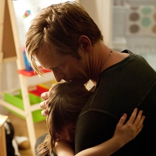 Onata Aprile stars as Maisie and Alexander Skarsgard stars as Lincoln in Millennium Entertainment's What Maisie Knew (2013)