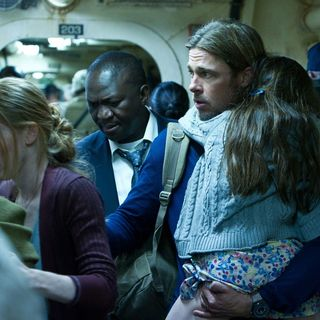 Mireille Enos stars as Karen Lane and Brad Pitt stars as Gerry Lane in Paramount Pictures' World War Z (2013)