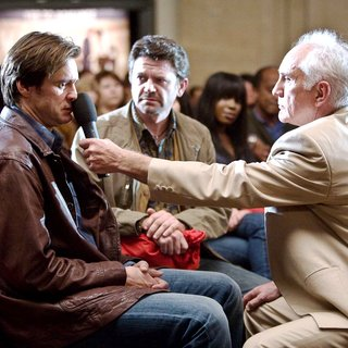 Jim Carrey, John Michael Higgins and Terence Stamp in Warner Bros. Pictures' Yes Man (2008). Photo by Melissa Moseley.
