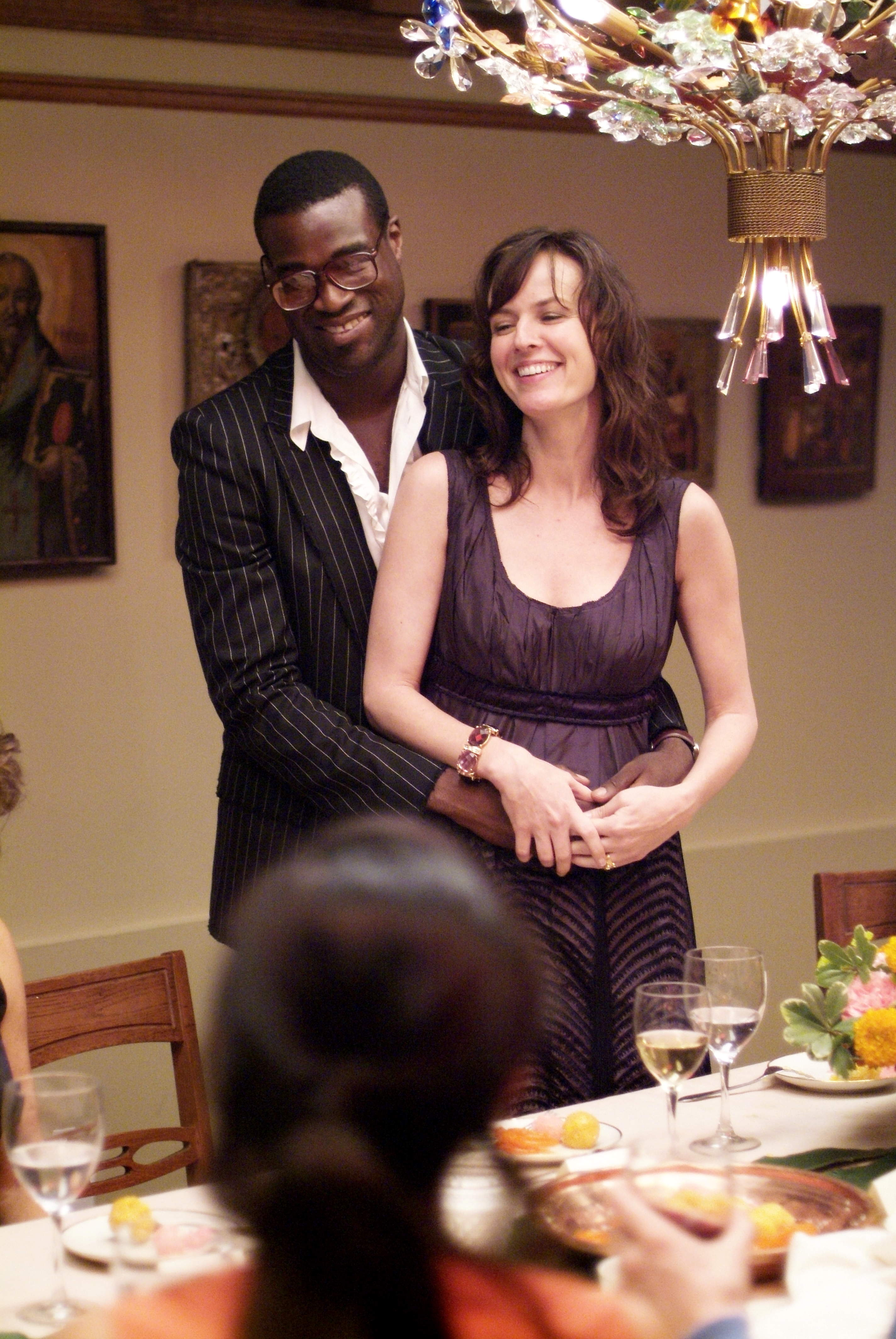 Tunde Adebimpe as Sidney and Rosemarie DeWitt as Rachel in Sony Pictures Classics' Rachel Getting Married (2008). Photo by Bob Vergara.