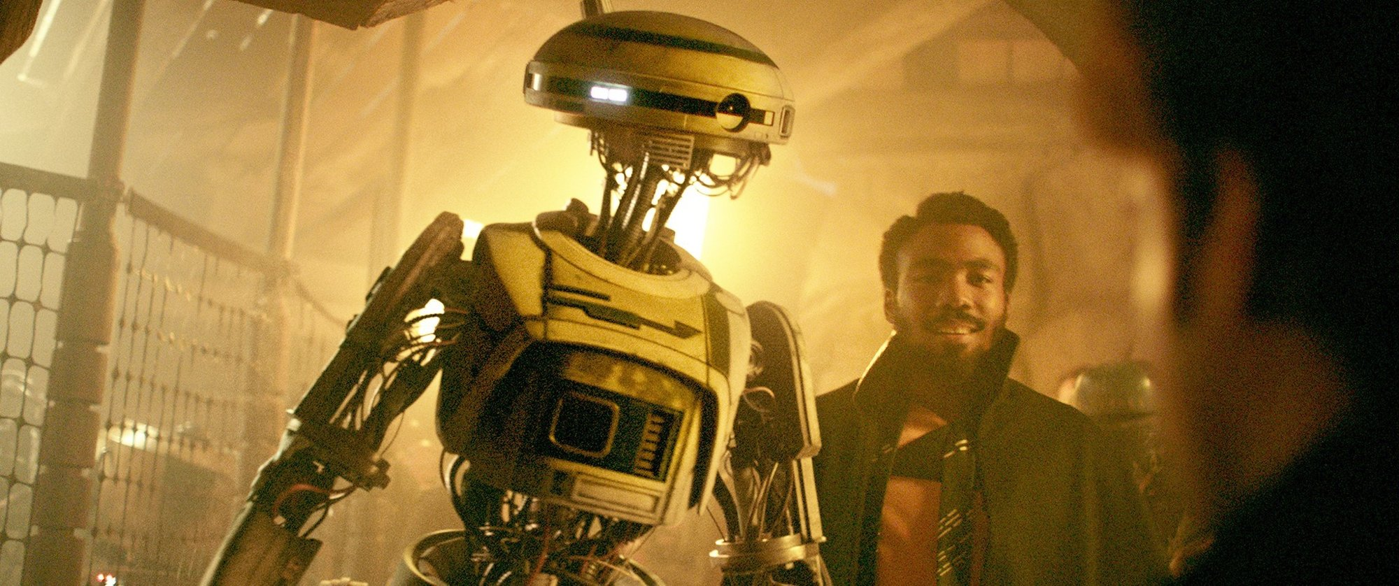 L3-37 and Lando Calrissian (Donald Glover) from Walt Disney Pictures' Solo: A Star Wars Story (2018)