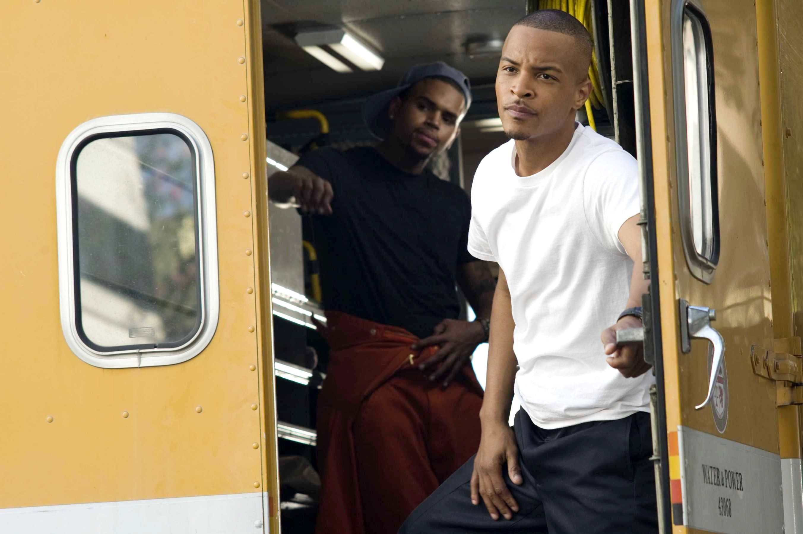Chris Brown stars as Jesse Attica and T.I. stars as Ghost in Screen Gems' Takers (2010)