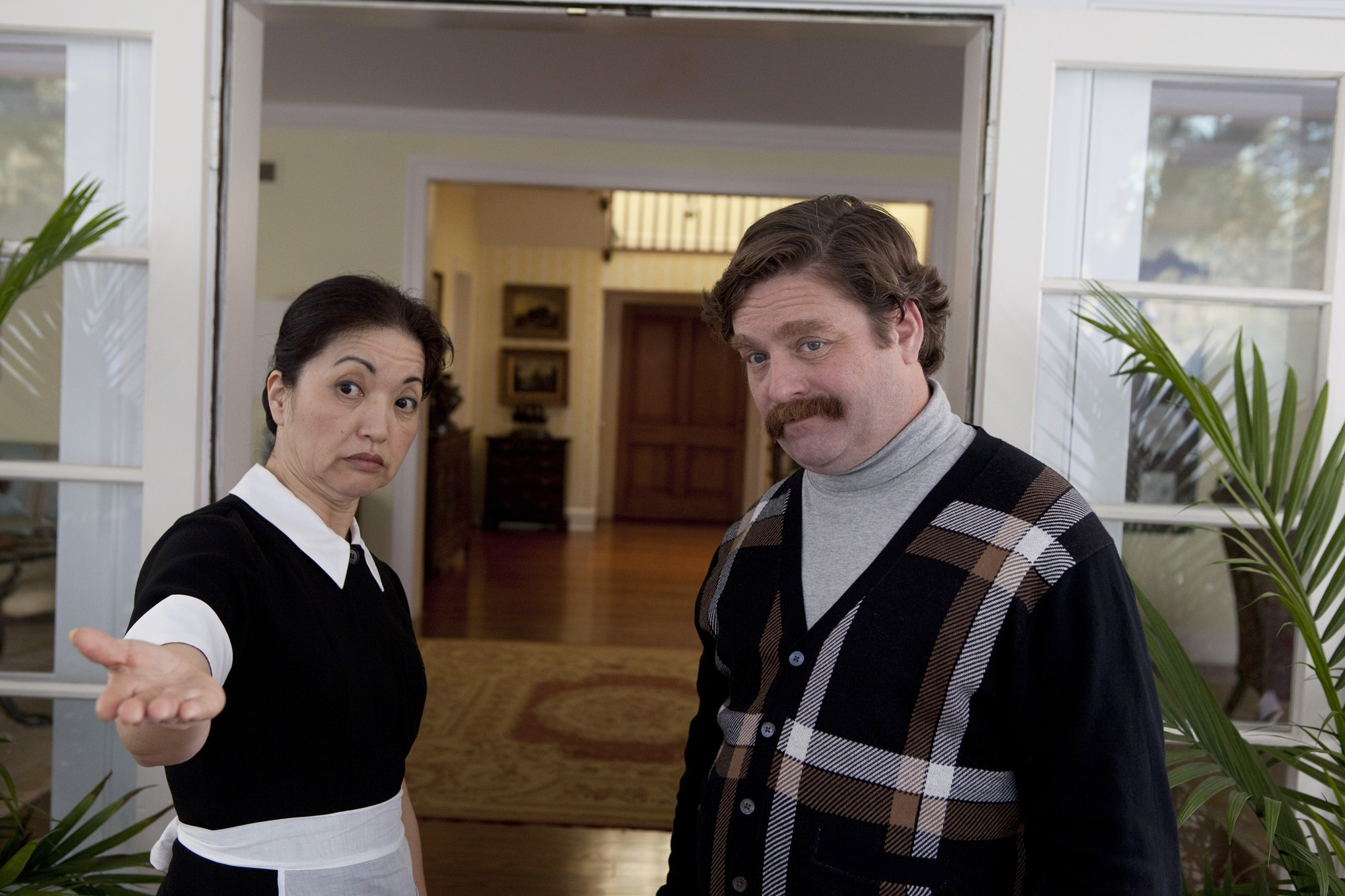 Karen Maruyama stars as Mrs. Yao and Zach Galifianakis stars as Marty Huggins in Warner Bros. Pictures' The Campaign (2012)