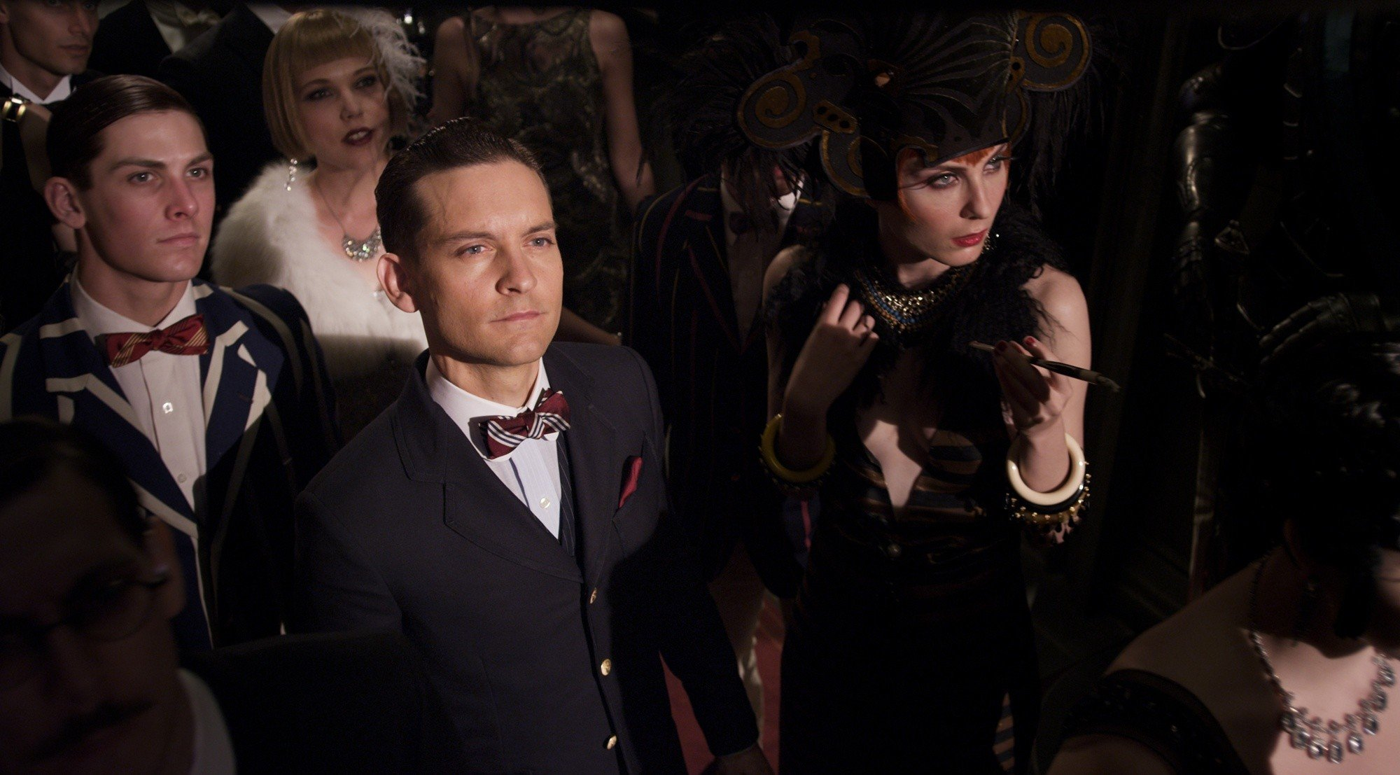 Tobey Maguire stars as Nick Carraway and Elizabeth Debicki stars as Jordan Baker in Warner Bros. Pictures' The Great Gatsby (2013)