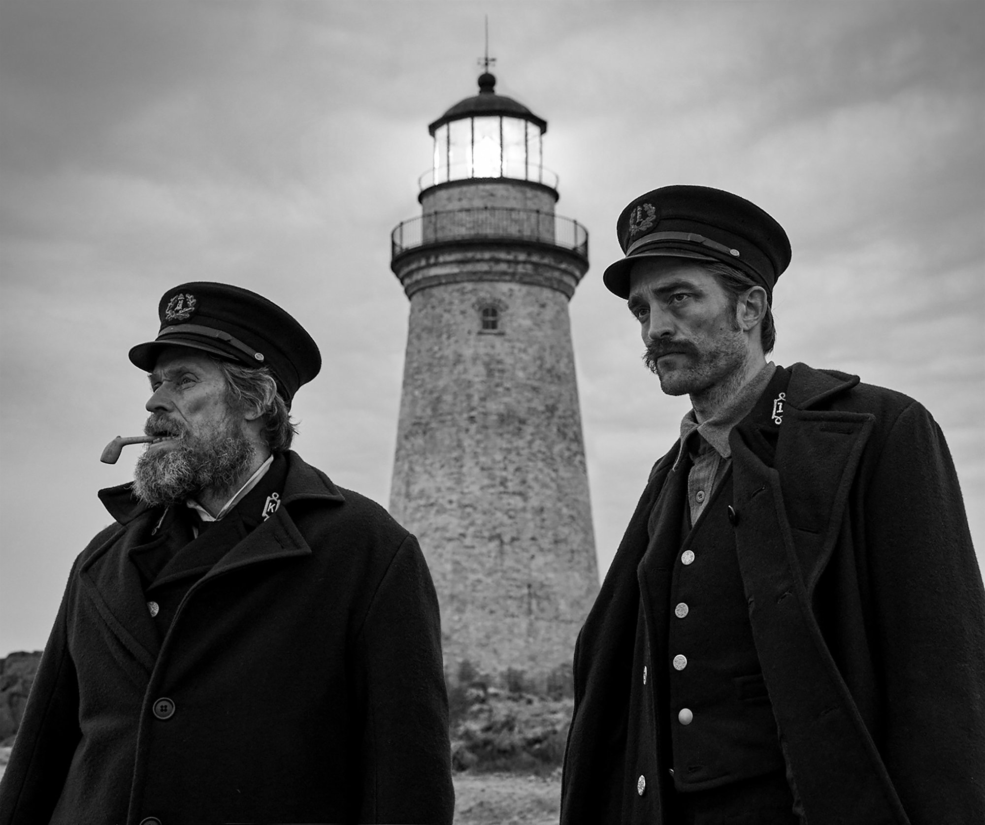 Willem Dafoe stars as Thomas Wake and Robert Pattinson stars as Ephraim Winslow in A24's The Lighthouse (2019)