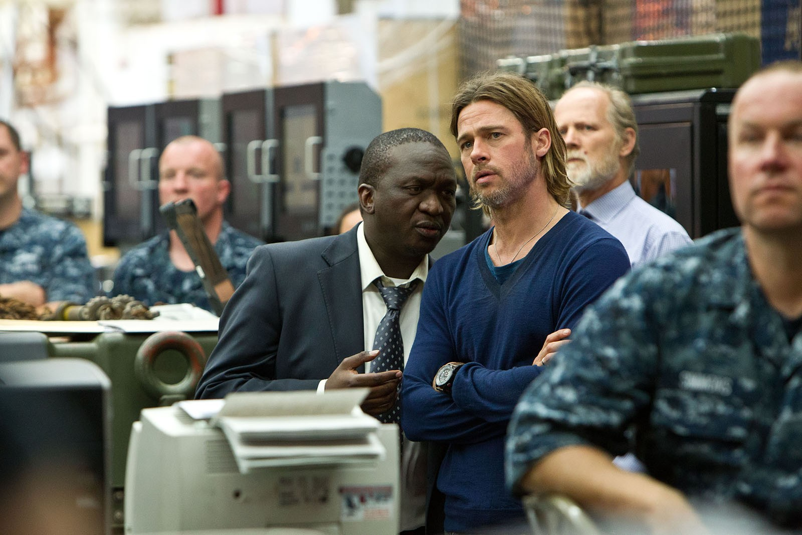 Fana Mokoena stars as Thierry and Brad Pitt stars as Gerry Lane in Paramount Pictures' World War Z (2013)
