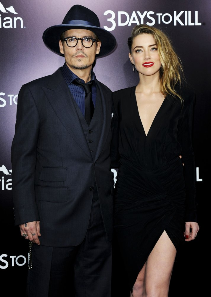 Johnny Depp, Amber Heard<br>3 Days to Kill Premiere - Red Carpet Arrivals
