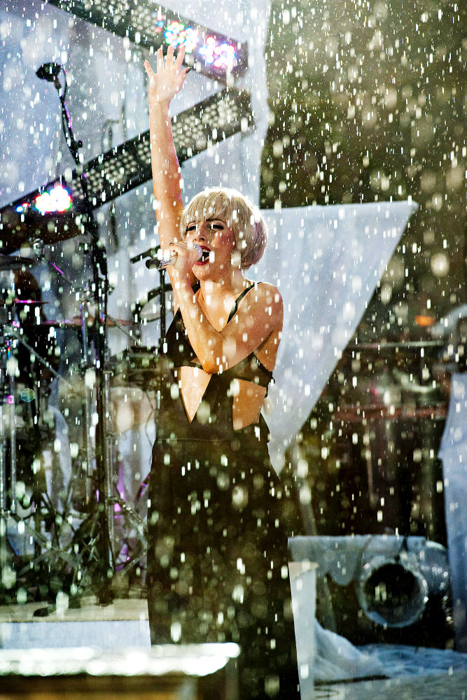 Pics: Lady GaGa Performing in Rain and Revealing Outfits