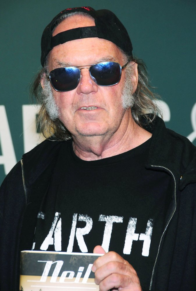 Neil Young<br>Neil Young Signs Copies of His Book Special Deluxe: A Memoir of Life and Cars