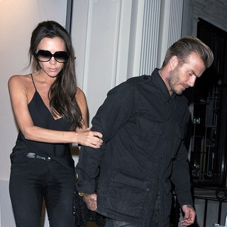 David Beckham - Victoria Beckham Led Out of Her Own Shop by David Beckham