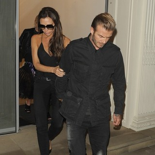 Victoria Adams - Victoria Beckham Led Out of Her Own Shop by David Beckham