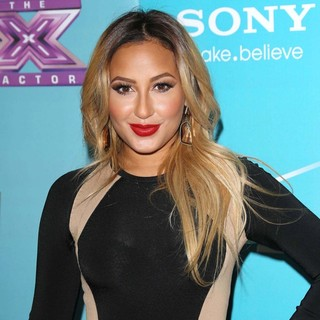 Adrienne Bailon in FOX's The X Factor Finalists Party - Arrivals - adrienne-bailon-the-x-factor-finalists-party-01