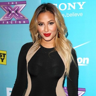 Adrienne Bailon in FOX's The X Factor Finalists Party - Arrivals - adrienne-bailon-the-x-factor-finalists-party-02