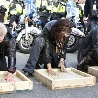 Joey Kramer, Joe Perry, Steven Tyler, Aerosmith in Aerosmith Leave Their Hand Prints After Performing in Front of 1325 Commonwealth Ave