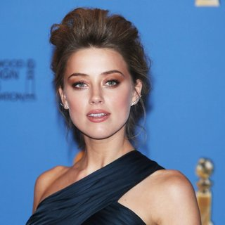 Amber Heard in 71st Annual Golden Globes - Press Room