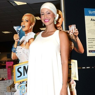 Amber Rose in Amber Rose Promotes-Signs Bottles of Smirnoff Fluffed Marshmallow and Whipped Cream Flavored Vodkas