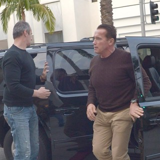 Arnold Schwarzenegger Heads to Prada on Christmas Eve