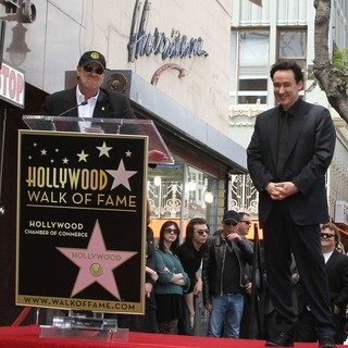 Dan Aykroyd, John Cusack in John Cusack Honored with A Star on The Hollywood Walk of Fame