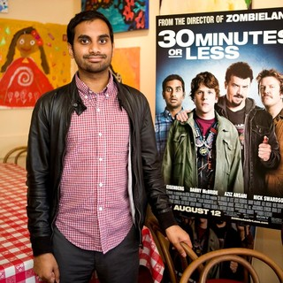 Aziz Ansari in Jesse Eisenberg and Aziz Ansari Serve Pizza to Promote 30 Minutes or Less