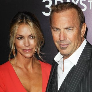 Christine Baumgartner, Kevin Costner in 3 Days to Kill Premiere - Red Carpet Arrivals