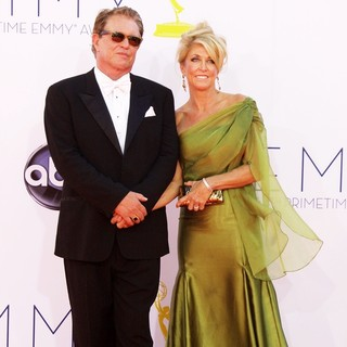 Tom Berenger, Patricia Alvaran in 64th Annual Primetime Emmy Awards - Arrivals