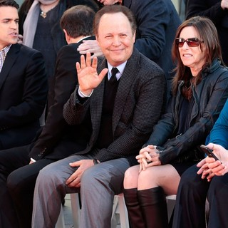 Billy Crystal in Robert De Niro Places His Hand and Foot Prints in Cement During The Footprint Ceremony