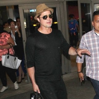 Brad Pitt Arrives at Los Angeles International Airport