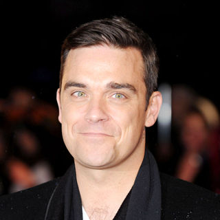 Robbie Williams in The BRIT Awards 2010 - 30th Anniversary - Arrivals