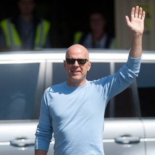 Bruce Willis in Bruce Willis Waves to Fans at Budapest Airport as He Arrives in The Hungarian Capital