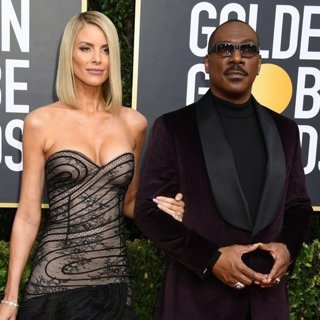 Paige Butcher, Eddie Murphy in 77th Annual Golden Globes - Arrivals