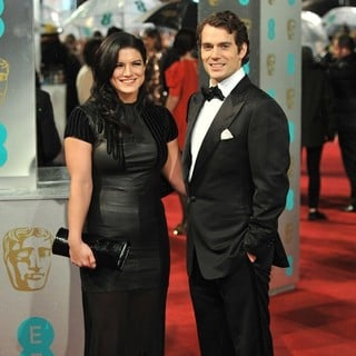 Gina Carano, Henry Cavill in The 2013 EE British Academy Film Awards - Arrivals