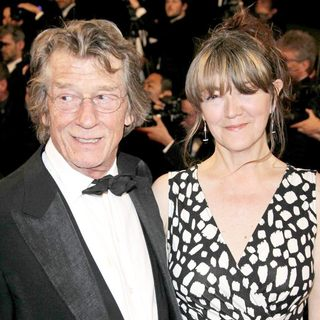 John Hurt, Anwen Rees-Myers in 2011 Cannes International Film Festival - Day 8 - Melancholia - Premiere