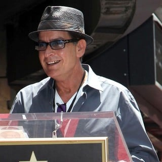 Charlie Sheen in Slash Honored with A Star on The Hollywood Walk of Fame
