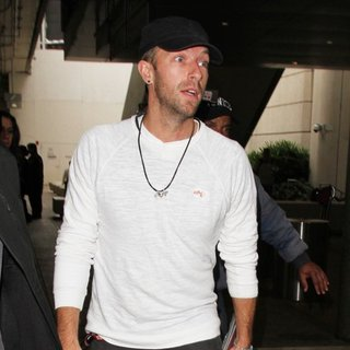 Coldplay - Chris Martin Arrives on A Flight to Los Angeles International Airport
