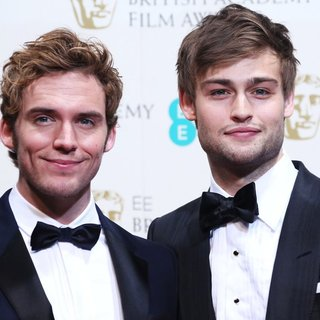 Sam Claflin, Douglas Booth in EE British Academy Film Awards 2014 - Press Room