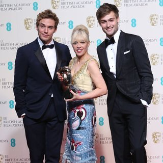 Sam Claflin, Catherine Martin, Douglas Booth in EE British Academy Film Awards 2014 - Press Room