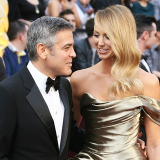 George Clooney, Stacy Keibler in 84th Annual Academy Awards - Arrivals