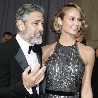 George Clooney, Stacy Keibler in The 85th Annual Oscars - Red Carpet Arrivals