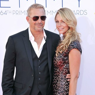 Kevin Costner, Christine Baumgartner in 64th Annual Primetime Emmy Awards - Arrivals